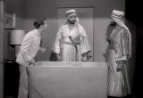 Still frame from: Margie and the Shah